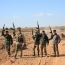 Syrian army attempts to seize key militant-held city in Idlib