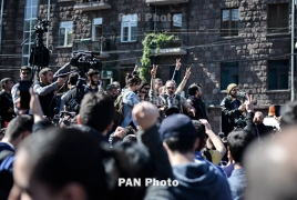 Clashes between police and protesters in Yerevan; the crowd tries to move up the street to parliament