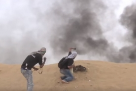 Palestinian protesters shoot down Israeli drone with stones