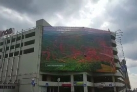 Promotional tourism videos about Armenia rolling on Moscow buildings