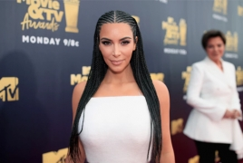 Kim Kardashian accepts MTV Movie & TV Award on behalf of her family