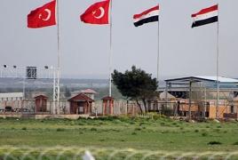 Militants storm Syrian army posts near Turkish border