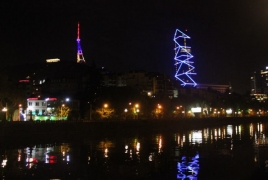 Tbilisi TV Tower lit in colors of Armenian flag