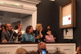 Banksy shreds his own painting after it sells for £1m