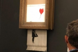 Buyer of Banksy's self-destructed painting keeps $1.4 mln worth deal