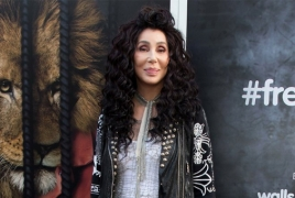 Cher says writing a book about herself, hints at movie for later