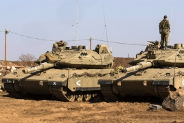 Israeli tank rolls across highway as crew falls asleep inside