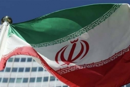 One guard dead, five hurt in attack as Iran marks anniversary