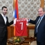 Henrikh Mkhitaryan presents Arsenal jersey to Armenian President