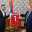 Henrikh Mkhitaryan presents Arsenal jersey to Armenian President