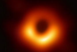 Astronomers take first ever image of a black hole