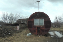 Family gets new home after living in metal container for 30 years