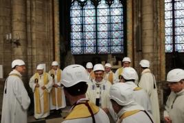 Worshippers wear helmets for first Notre-Dame mass since fire
