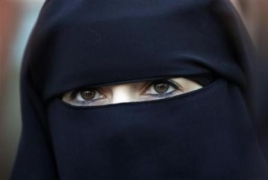 Tunisia bans niqabs in public institutions after twin bombings