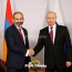 Putin invites Armenia's Pashinyan to Russia