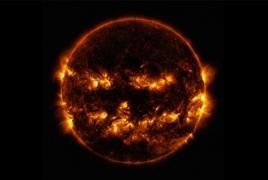NASA shares photo of sun looking like a giant flaming jack-o'-lantern