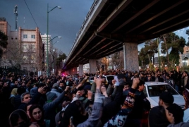 Thousands hit streets in Iran to condemn leaders over downed plane