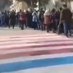 Tehran students refuse to walk on U.S., Israeli flags