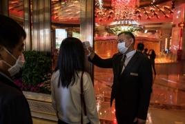В Китае число новых заражений коронавирусом за сутки упало вчетверо