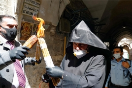 Orthodox ceremony of Holy Fire takes place in deserted Jerusalem