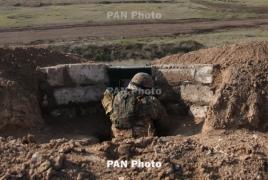 Azerbaijani troops use mortars to fire on Karabakh positions