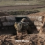 Azerbaijani troops use sniper rifles to fire on Armenian positions