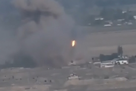 Azerbaijani army filmed firing TOS-1A systems from inside villages