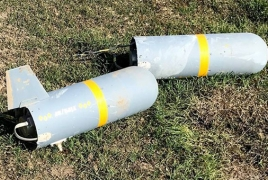 Karabakh displays one more Bayraktar drone with unexploded missiles