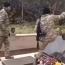 Azeri troops filmed toppling, destroying Armenian tombstones