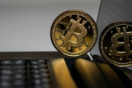 Bitcoin tops $40,000, before sliding back to $38,000