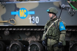 Russian peacekeepers clear agricultural fields from Uragan ammo