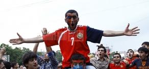 Armenian fans watching Russia-Armenia football game