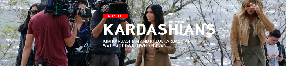 Kim Kardashian and Khloé Kardashian walk at downtown Yerevan
