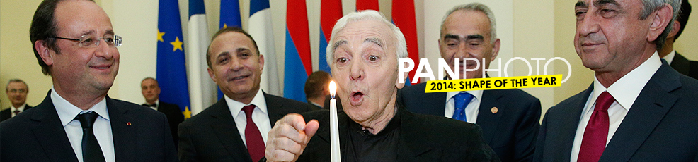 Charles Aznavour blowing out his birthday candle during the state supper at the Presidential Palace of Armenia