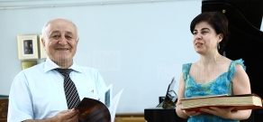 RA Deputy Minister of Diaspora Samvel Petrosyan hands on the score of