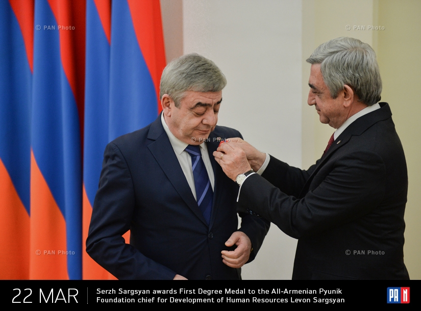 Armenian President Serzh Sargsyan awards the First Degree Medal of Services Rendered to Fatherland to the Head of  Executive Body of the All-Armenian Pyunik Foundation for the Development of Human Resources, his brother Levon Sargsyan