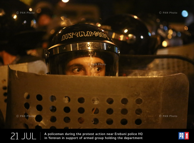 A policeman during the protest action near Erebuni police HQ in Yerevan in support of armed group holding the department