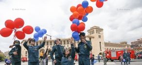 Festive parade of fire fighters and rescuers entitled 'May 911' in Republic Square
