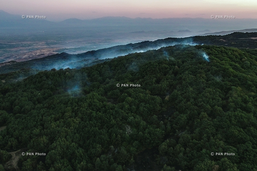 Fire rages in the vegetated area near the Armenian village of Byurakan