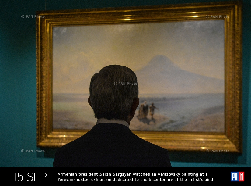 Armenian president Serzh Sargsyan watches an Aivazovsky painting at a Yerevan-hosted exhibition dedicated to the bicentenary of the artist's birth