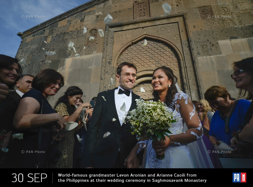 World-famous grandmaster Levon Aronian and Arianne Caoili from the Philippines at their wedding ceremony in Saghmosavank Monastery