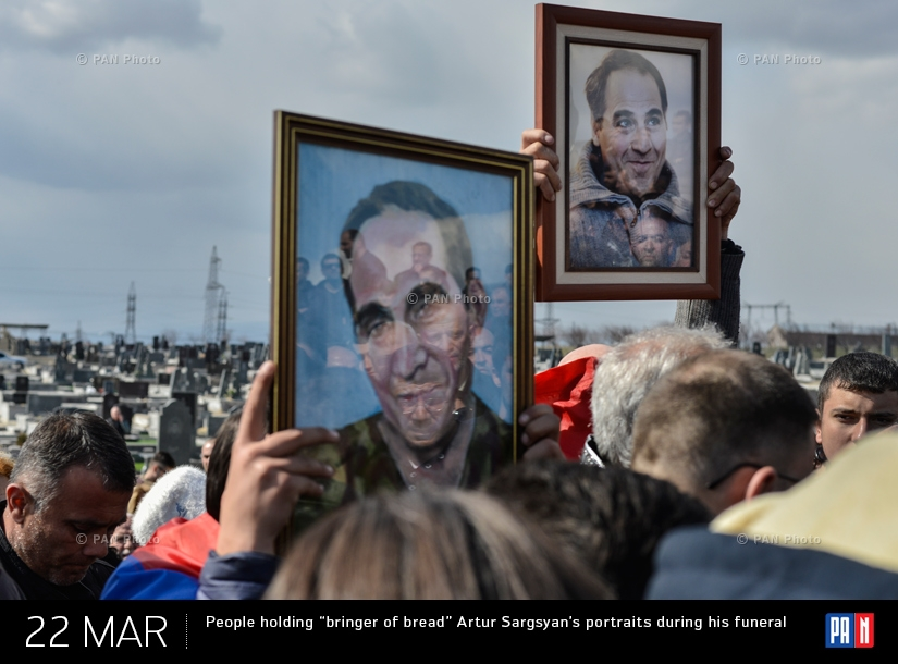 "People holding ""bringer of bread"" Artur Sargsyan's portraits during his funeral"
