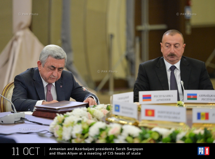 Armenian and Azerbaijani presidents Serzh Sargsyan and Ilham Aliyev at a meeting of CIS heads of state