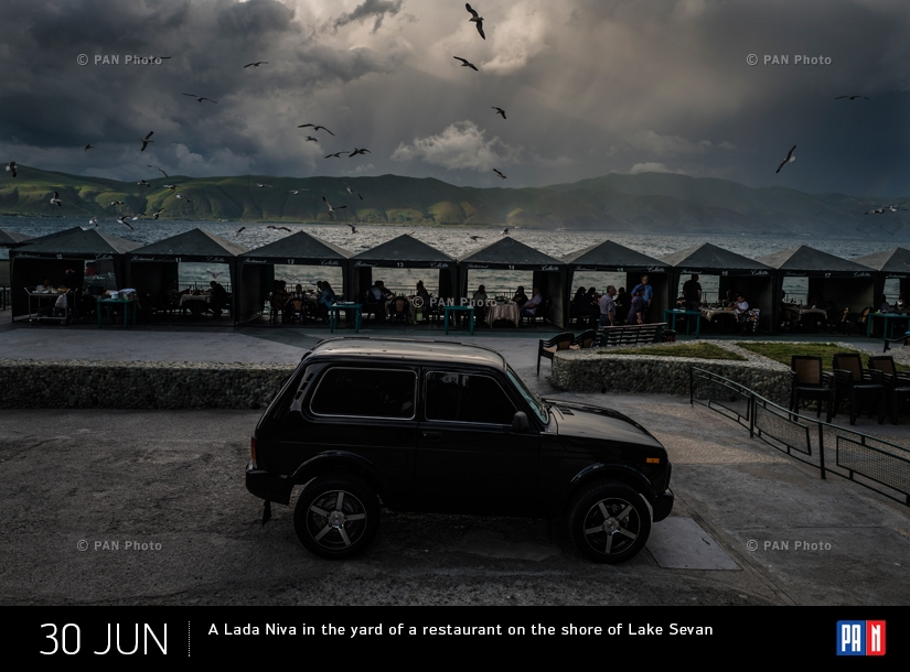 A Lada Niva in the yard of a restaurant on the shore of Lake Sevan
