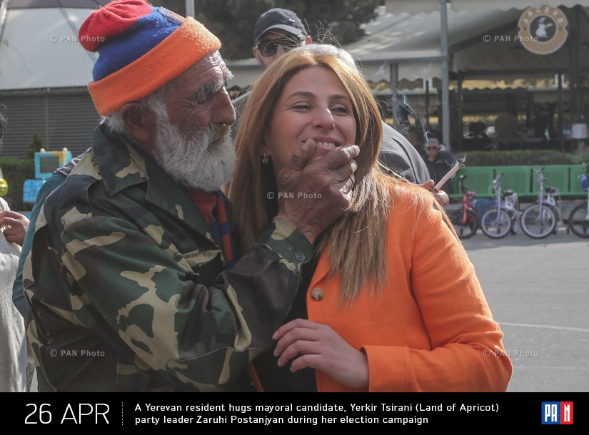 A Yerevan resident hugs mayoral candidate, Yerkir Tsirani (Land of Apricot) party leader Zaruhi Postanjyan during her election campaign