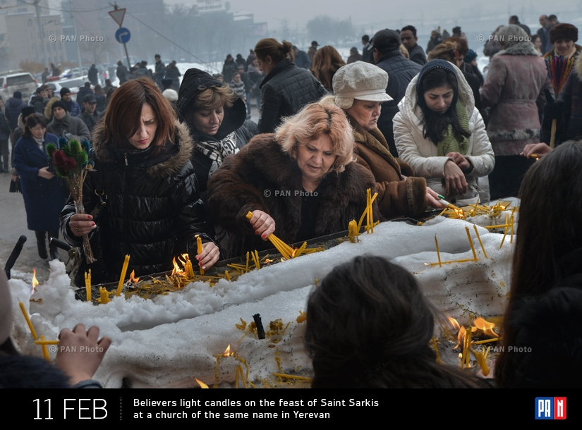 Believers light candles on the feast of Saint Sarkis at a church of the same name in Yerevan