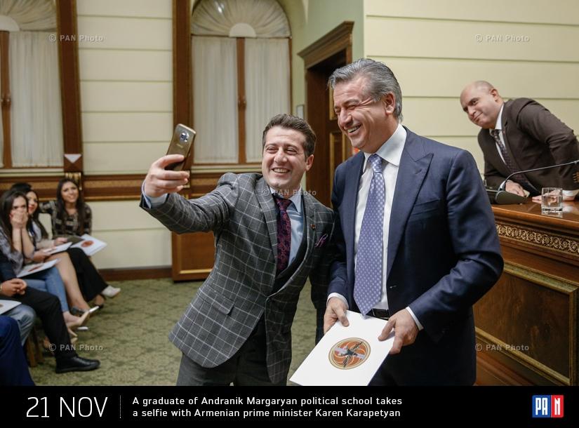 A graduate of Andranik Margaryan political school takes a selfie with Armenian prime minister Karen Karapetyan
