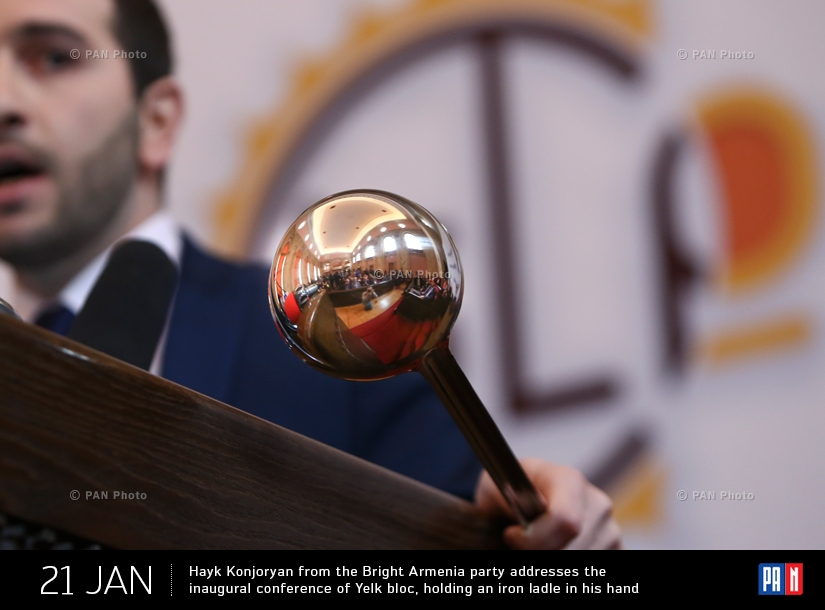 Hayk Konjoryan from the Bright Armenia party addresses the inaugural conference of Yelk bloc, holding an iron ladle in his hand