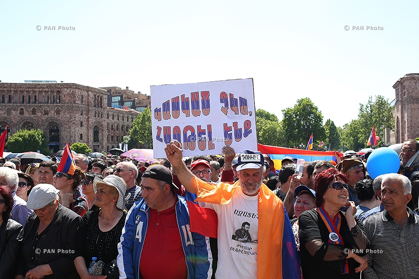 The Armenian citizens watching a special parliament sitting on the election of new Prime Minister