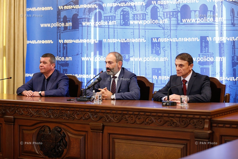 Armenian Prime Minister Nikol Pashinyan, alongside former Police Chief Vladimir Gasparyan, presents newly appointed Chief of Police Valery Osipyan to the senior staff and board members of the Police